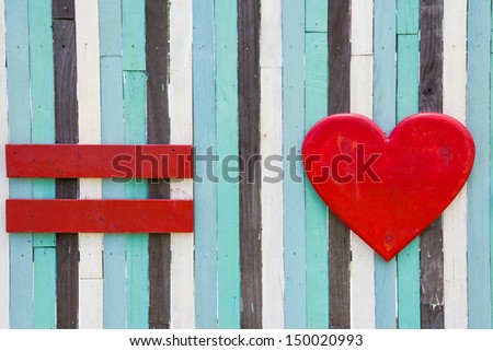 red symbol of equal and love on wood background - stock photo