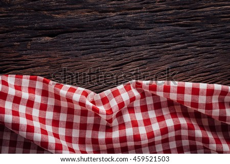 red tablecloth on wooden background, tablecloth with wooden background - stock photo