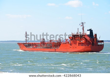 Red tanker cargo ship sailing to port in Vlissingen, the Netherlands - stock photo