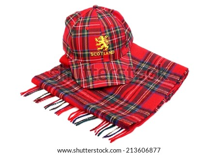 Red tartan cap with scottish arms and tartan scarves Isolated on White - stock photo