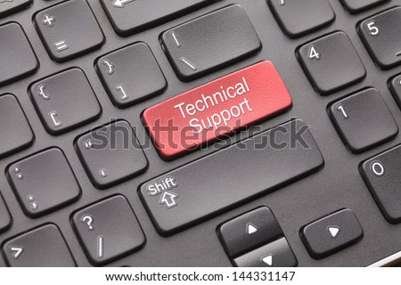 Red technical support key on black keyboard - stock photo