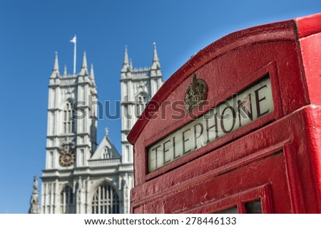 Red Telephone Booth and Westminster Abbey in London - stock photo