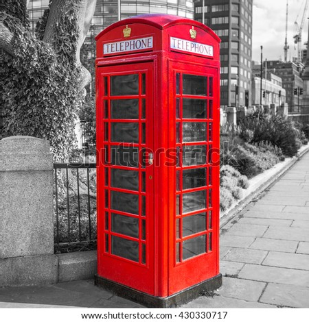 Red telephone booth on the street of London, UK - stock photo
