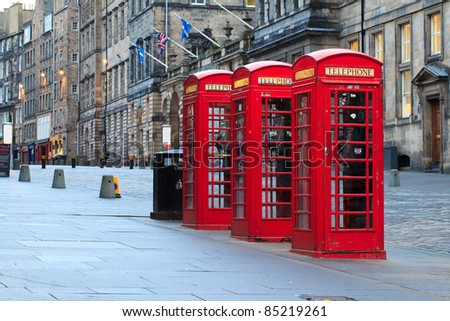 Red telephone booths along the famous royal mile in Edinburgh, capital of Scotland - stock photo