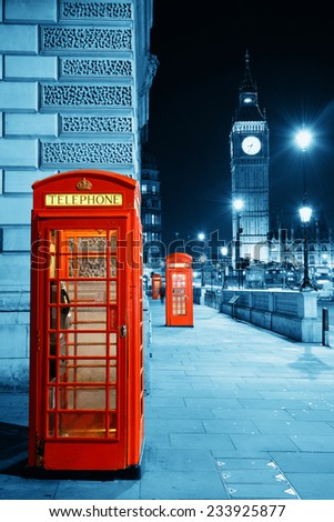 Red telephone box and Big Ben in Westminster in London. - stock photo