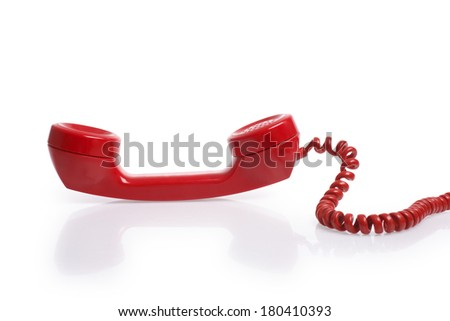 Red telephone reciever on white background - stock photo