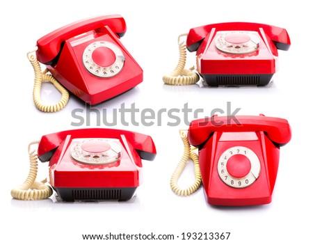Red telephones on white - stock photo