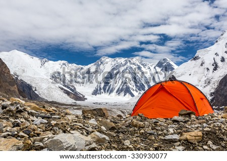 Red Tent in High Altitude Mountain Terrain - stock photo
