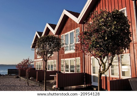 Red terrace house in evening light - stock photo