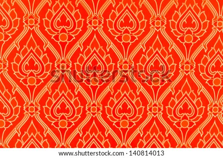 Red Thai-art wallpaper with a nice lotus pattern - stock photo