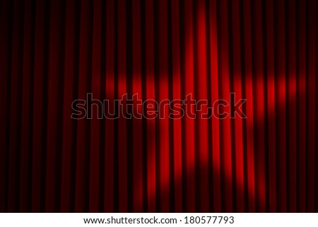 Red Theater Stage Curtains with Star Spotlight. - stock photo