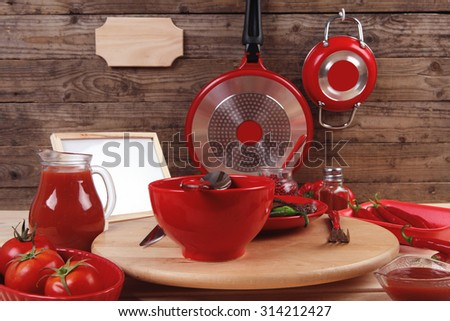 red theme lunch  fresh grilled bbq roast beef steak red plate green chili tomato soup ketchup sauce small jug glass ground pepper american peppercorn modern cutlery served wooden table empty nameplate - stock photo