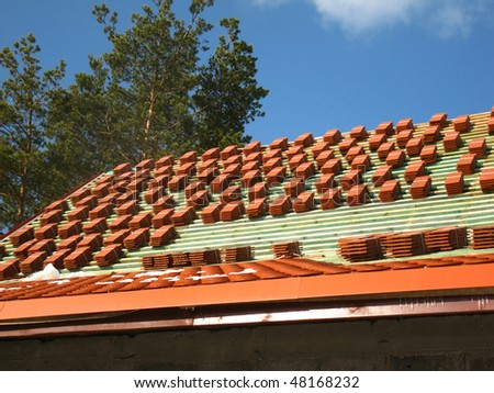 red tile roof in stacks before laying - stock photo