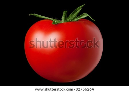 Red tomato on a black background. Kind with a side. - stock photo