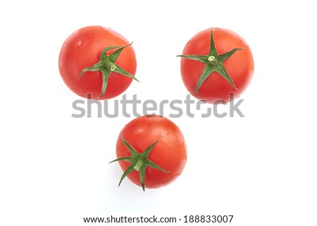 Red tomatoes isolated on a white background. - stock photo