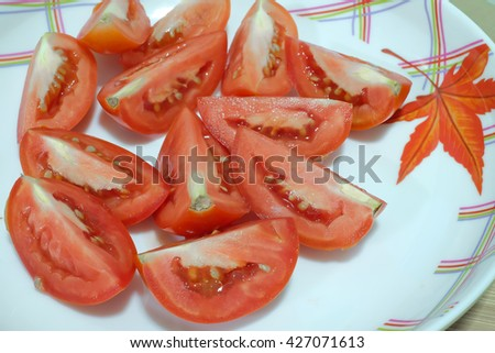 Red tomatoes on dish background, Fresh red tomato closeup. Cut tomato on white. Bunch of tomatoes photoshot. Fresh vegetable tomato. Tomato soup cooking. Raw food for vegetarians, tomato salad cook. - stock photo