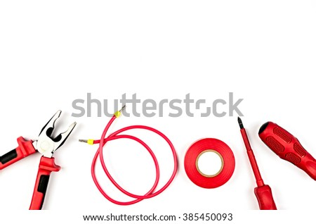 Red tools collection - electrical cable, pliers, insulating tape, screwdriver - stock photo