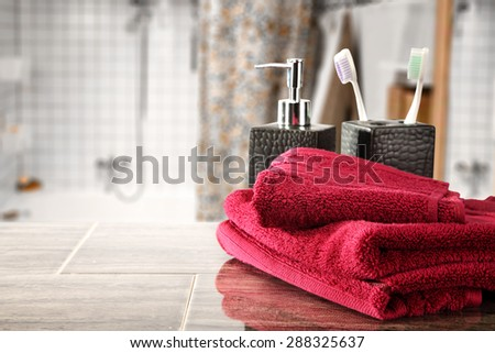 red towel decoration in bathroom and free space for you  - stock photo