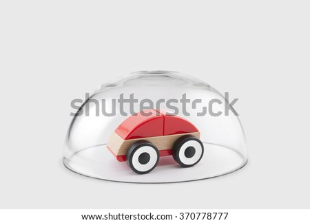 Red toy car protected under a glass dome  - stock photo
