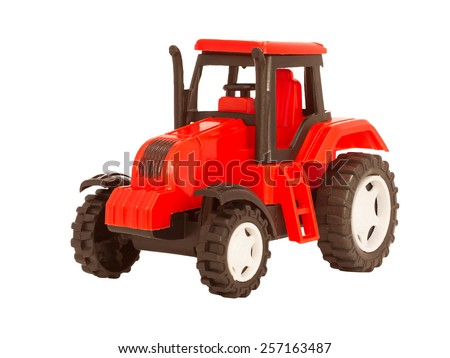 red toy tractor on a white background - stock photo