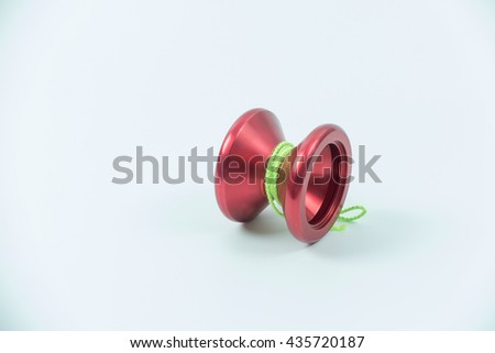 red toy yo yo isolated on white background - stock photo