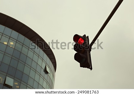 Red traffic light in the city, Traffic lights against sky backgrounds, vintage color filter - stock photo