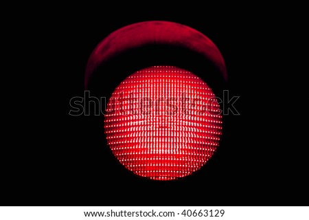 red traffic light, isolated on black background - stock photo