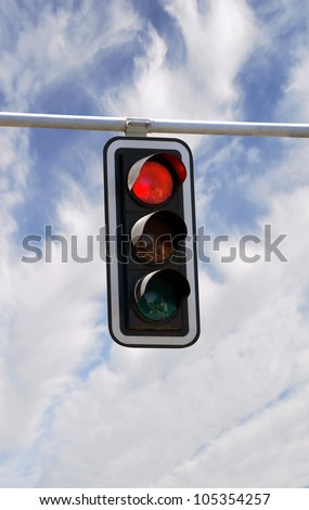 Red traffic lights against blue sky backgrounds with clipping path - stock photo