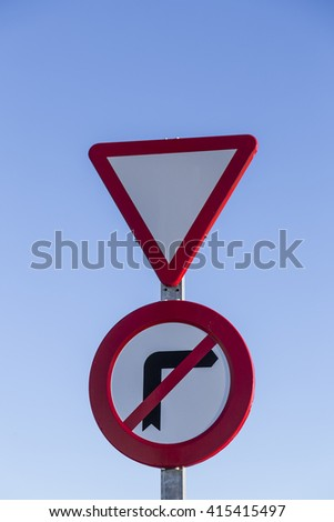 red traffic signal caution and red triangle and circle prohibition - stock photo