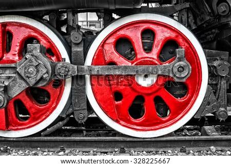 Red train wheels - stock photo