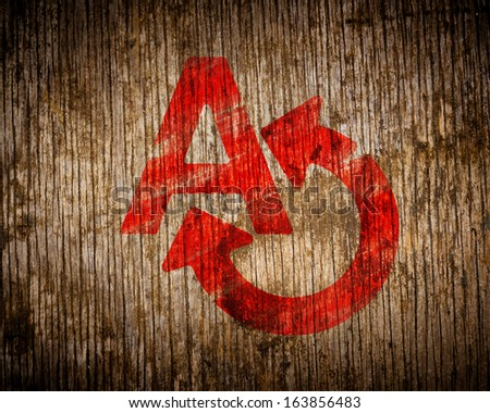 Red Translating Icon Painted by Stencil on Wood. Grunge Background. - stock photo