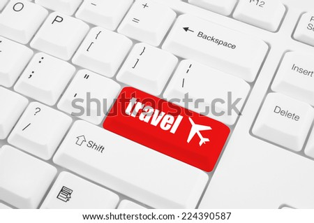 Red travel button on the white keyboard - stock photo