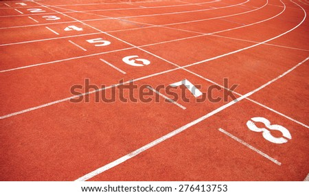 Red treadmill at the stadium with the numbering from one to eight - stock photo