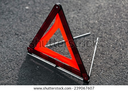 Red triangle of a car - stock photo