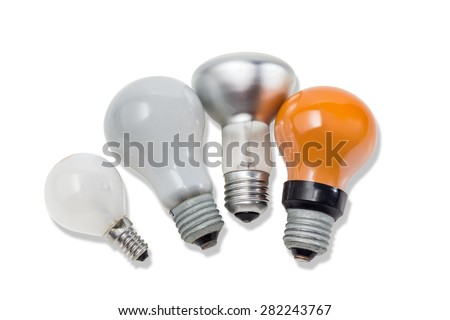 Red, two matte electric incandescent lamps different sizes and a lamp with a specular coated of bulb on a light background. Isolation. - stock photo