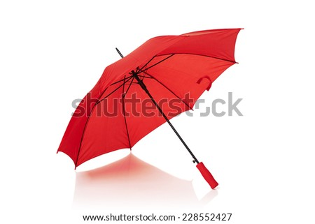 Red umbrella or parasol with red handle isolated on white background - stock photo