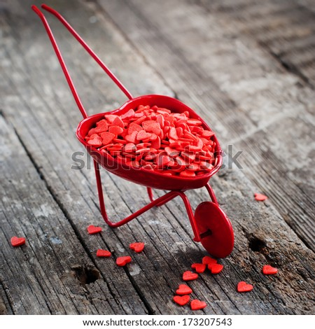Red Valentine Cart and Tiny Hearts, on Wooden Background - stock photo