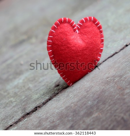 Red Valentine heart on wood background, one lonely heart in Valentine day, a special day for couple on feb 14, a abstract concept for love - stock photo