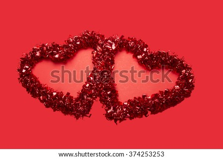 Red Valentine hearts/Two Red Valentine Hearts/Valentine hearts on red background - stock photo