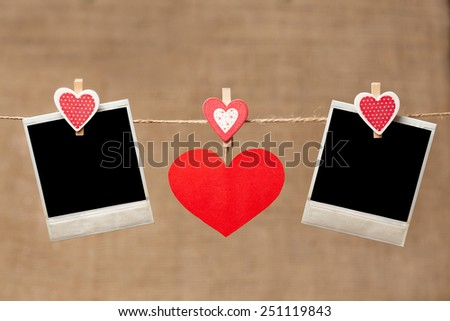 Red valentine's day hearts on vintage wooden background with frame for design text  - stock photo