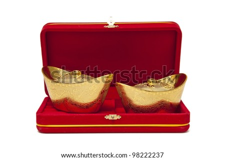 Red velvet box and chinese gold isolated on white background - stock photo