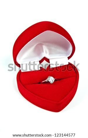 Red velvet box for an engagement ring on white background - stock photo