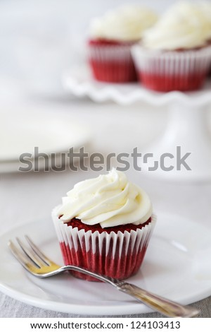 Red velvet cupcakes with cream cheese frosting - stock photo
