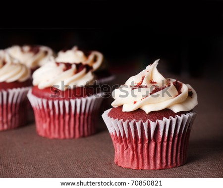 red velvet cupcakes with cream cheese icing - stock photo