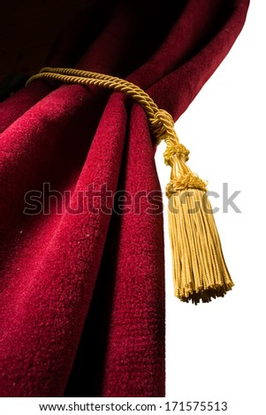 Red velvet curtain with tassel. Close up white isolated curtain - stock photo