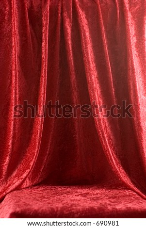 Red velvet draped for backdrop or stage - stock photo