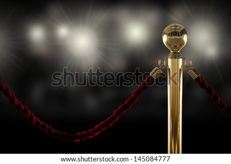 Red velvet rope barrier close-up with flash light on background - stock photo