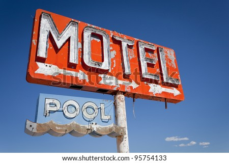 Red, vintage, neon motel sign on historic route 66 in front of blue sky - stock photo