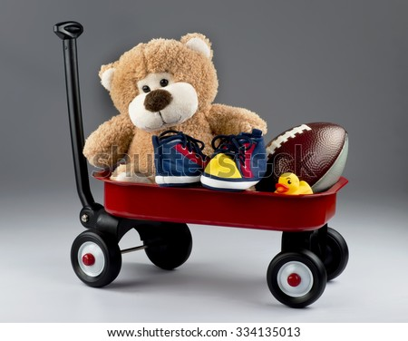 Red wagon full of kids favorite toys. - stock photo