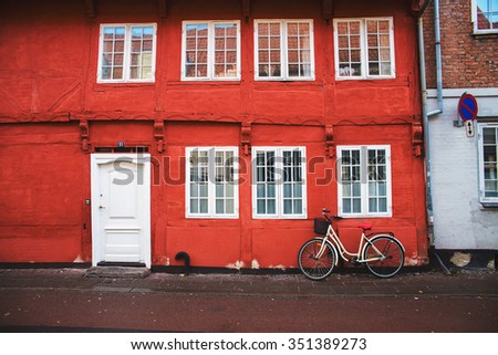 red wall of an old building in Helsingor - stock photo